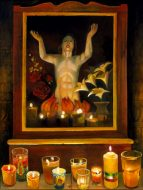 A painting of Jesus surrounded by roses and lilies sits on an altar, with a line of lit candles in front of the painting
