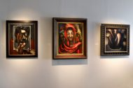 Installation shot of two painted portraits and a landscape by David Alfaro Siqueiros