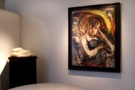 Installation shot of a painted portrait by David Alfaro Siqueiros and a white onyx sculpture of a reclining nude