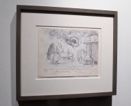 A framed drawing by Leonora Carrington hanging on a wall