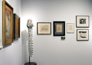Installation shot of the gallery's booth at The Art Show 2019, a corner with a large vertical glass sculpture