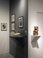 Installation shot of the gallery's booth at The Art Show 2019, featuring a wooden cat sculpture
