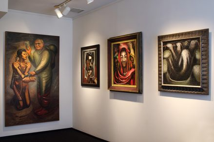 Installation shot with four paintings by David Alfaro Siqueiros in the back gallery