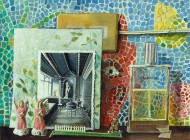A painting of a blue, green, red and yellow mosaic wall, inf front of which are a black and white photograph, a bottle of perfume, and two pink angel figurines